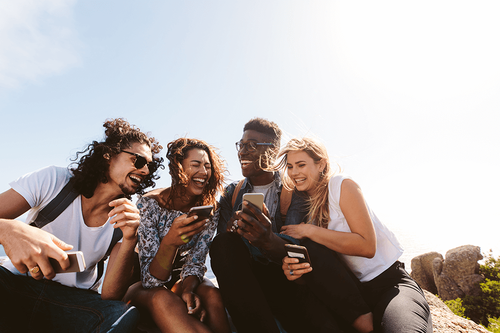 Group of young happy people with mobiles laughing