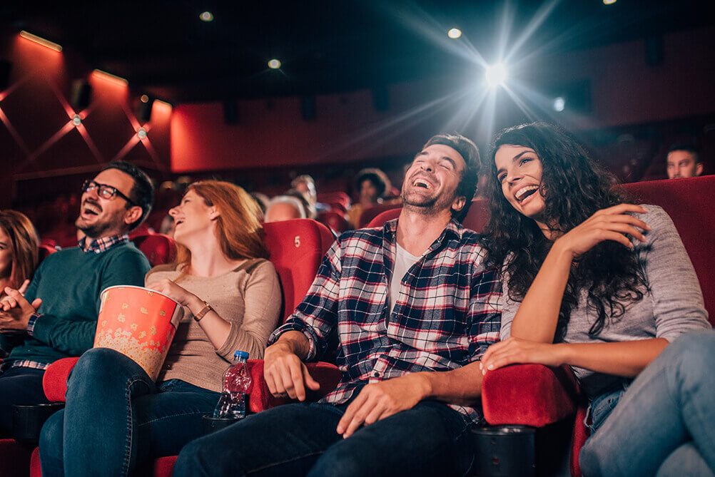 People enjoying a movie from Hollywood